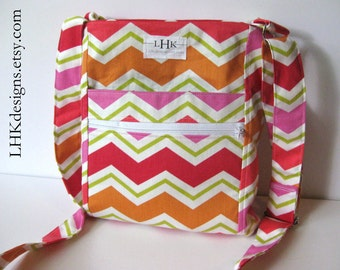 Chevron crossbody purse in pink, red, orange and lime green with adjustable strap