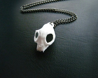 Cat Skull Necklace in white - A white cat skull necklace on a gunmetal chain to adorn your neck