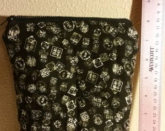 Quilted, zippered pouch.  Make up bag, clutch