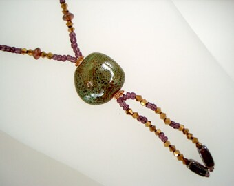 Green Purple Gold Long Beaded mardi gras colors bolo style necklace with green speckled ceramic focal