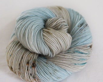 By The Sea - Magpie -  75/20/5 superwash merino/ nylon/ gold stellina sock yarn