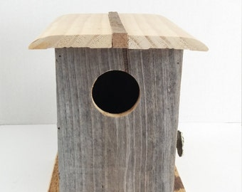 Rustic hand crafted bird house raw wood greay wood
