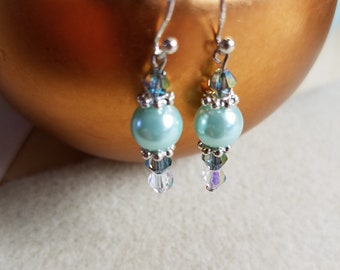 Light teal pearls with silver accents.