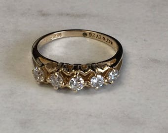 14kt Yellow Gold Lady's Diamond Wedding/Anniversary Band at a Very Affordable Price.