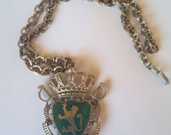 Vintage coat of arms necklace green enamel lion swords and crown with gold tone