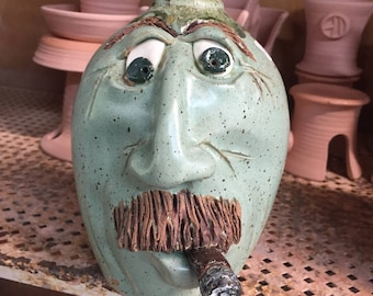 Green cigar face jug