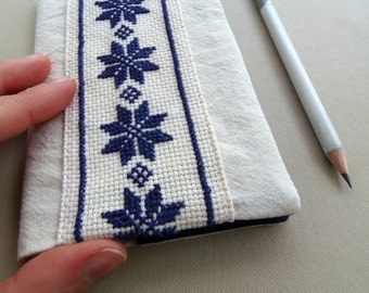 Nordic Moleskine cahier cover. Embroidered Moleskine with blue stars on cream. Scandinavian style embroidery