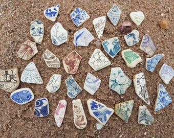 30 sea worn pottery pieces,flat back and smooth edges,medium in size,perfect for all types of sea crafts.