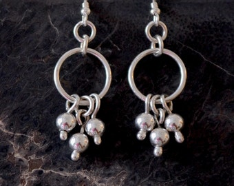 Sterling silver Cha Cha earrings.  hand made.  'Cha Cha Ching'