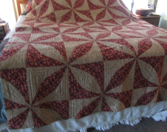 vintage quilt, dark reds, tan and green, hand quilted