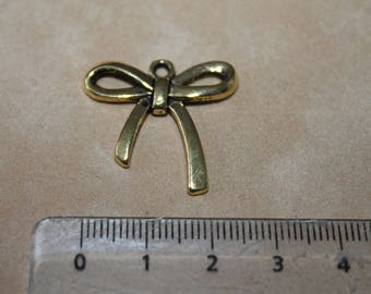 Bow - gold metal charm