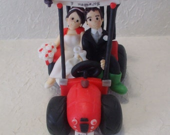 Custom bride and groom on tractor wedding cake topper