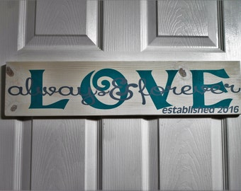 Love always and forever painted on  reclaimed wood.