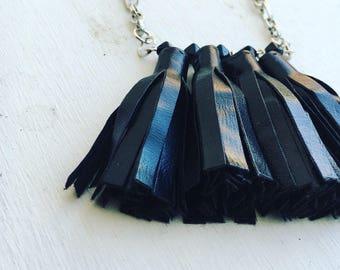Fringe vegan leather tassel necklace.