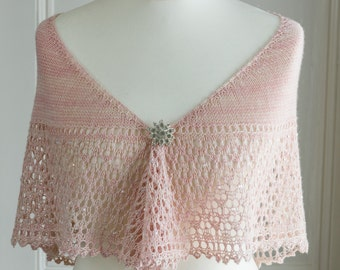 Bridal shawl in a crescent shape, knit with a pale creamy pink coloured baby yak and silk yarn, with iridescent beads