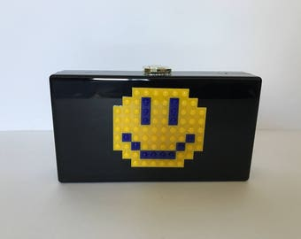 The happy face clutch