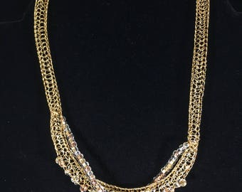 Gold hand crocheted from wire with beads necklace