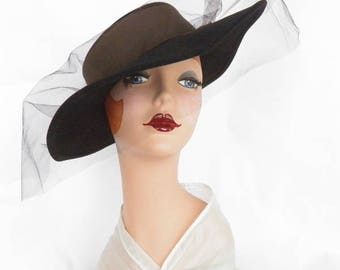 Woman's black hat, vintage 1970s, Mr. John. New Old Stock, New York Paris