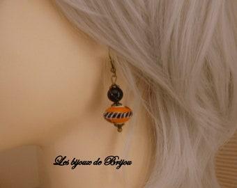 orange and black glass bead earrings