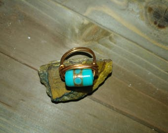 Copper wire wrapped light blue glass ring