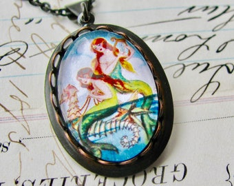 Mermaids on a Seahorse necklace made with Fallen Angel Brass, handmade glass cabochon, black brass, mermaid necklace, nautical lore stories