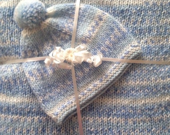 Blue and white jacquard baby blanket, hat, and booties