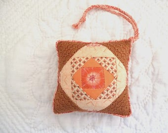 Small Patchwork Pincushion made from brown and orange Cotton Fabrics