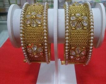 Gold plated with imitation American diamond bangles