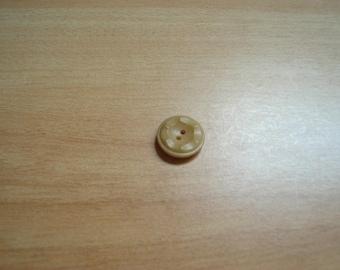 round beige buttons with design