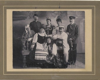 Elaborate costume party soldiers ethnic outfits antique fashion photo