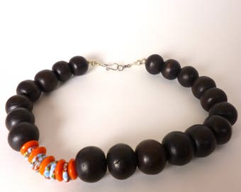 wood, coral, and glass beaded necklace