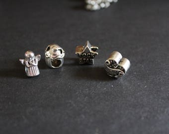 4 different Tibetan style silver lampwork beads