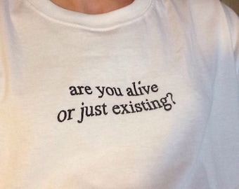 Are You Alive Or Just Existing? T-shirt / Premium Quality ! - Made in London / Fast Delivery to the Usa , Canada , Australia & Europe !