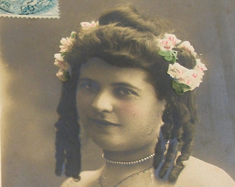 1904 French postcard, Actress with tight curls. RPPC real photo postcard, paper ephemera.