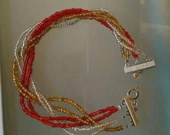 Handmade beaded bracelet is three colors