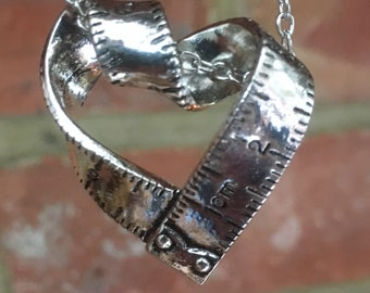 "Silver Plated Heart Shaped Tape Measure Pendant Necklace: ""My Love For You Cannot Be Measured"""