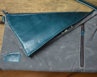 Teal leather fold over purse with gray waxed canvas