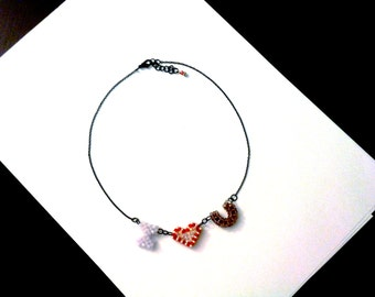necklace with beaded heart and letters in Swarovski crystals