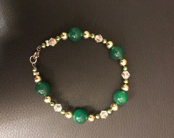 Green, gold, and clear beaded bracelet