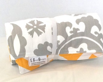 Changing mat padded, travel changing pad, yellow and white chevron with grey and white on alternate side