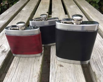 Leather bound hip flasks with press stud detail in black and burgundy