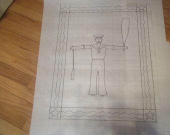 Primitive sailor whirligig rug hooking pattern on gridded trace fabric