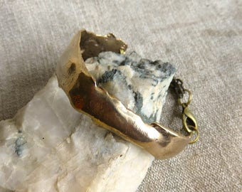 Cast bronze bracelet.