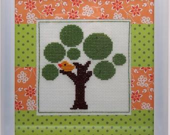 Orange bird in tree