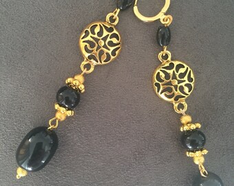 Earrings with obsidian stone