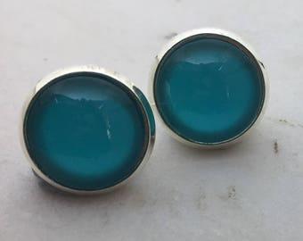 Aqua glass dome stud earrings. 14mm with surgical steel and nickel free posts