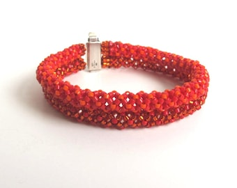 Double strand Red Hot Tamale friendship bracelet with Sterling silver slide clasp. 6 1/4 inch long. 16cm long.