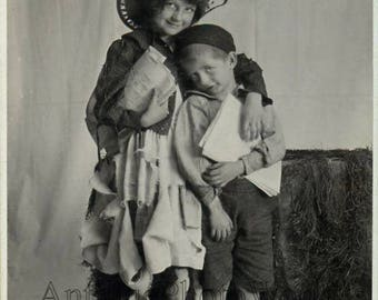 Barefoot children dressed as hobos antique photo