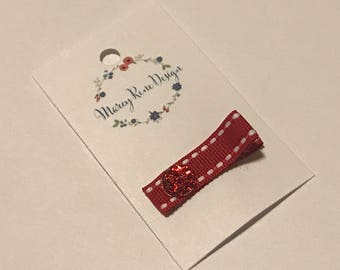 Red hair clip with jewel and white pinstripes