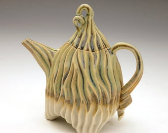 Green, tan and white carved porcelain teapot with grooves